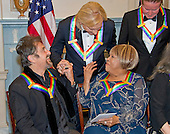 Al Pacino, left, one of the five recipients of the 39th Annual Kennedy Center Honors, gospel and blues singer Mavis Staples, right, and Joe Walsh of the rock band &quot;The Eagles,&quot; center, congratulate one another as they prepare to pose for a group photo following a dinner hosted by United States Secretary of State John F. Kerry in their honor at the U.S. Department of State in Washington, D.C. on Saturday, December 3, 2016.  The 2016 honorees are: Argentine pianist Martha Argerich; rock band the Eagles; screen and stage actor Al Pacino; gospel and blues singer Mavis Staples; and musician James Taylor.<br /> Credit: Ron Sachs / Pool via CNP