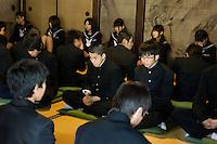 pupils in uniform visiting a Zen temple in Kyoto, Japan
