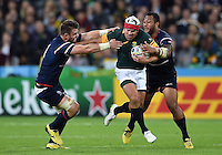 Schalk Brits of South Africa takes on the USA defence. Rugby World Cup Pool B match between South Africa and the USA on October 7, 2015 at The Stadium, Queen Elizabeth Olympic Park in London, England. Photo by: Patrick Khachfe / Onside Images