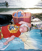 Felix sunburnt and asleep by the edge of the sea. Puerto Escondido during spring break (semana santa) vacation 2006
