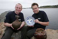 Marek E. Jasinski (left) and Fredrik Søreide  from The Museum of Natural History and Archaeology, at The Norwegian University of Science and Technology in Trondheim, with objects they retrieved from the wreck. ©Fredrik Naumann/Felix Features