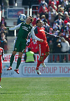 26 March 2011: Toronto FC midfielder Dwayne De Rosario #14 and Portland Timbers midfielder Ryan Pore #23 in action during an MLS game between the Portland Timbers and the Toronto FC at BMO Field in Toronto, Ontario Canada....