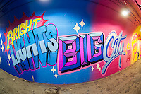 A  portion of  the 900-foot long 191st Subway station connecting tunnel, painted by Queen Andrea, and newly decorated by artists hired by the New York City Dept. of Transportation on Thursday, May 21, 2015. The artists, COPE2, Queen Andrea, Nick Kuszyk, Cekis and Jessie Unterhalter and Katey Truhn were chosen in a competitive process by the DOT. The tunnel has recently received upgraded LED lighting and with the addition of the murals has been turned into an art gallery. (© Richard B. Levine)