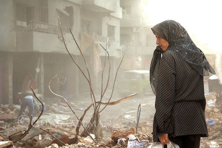 A local resident surveys the remains of her apartment block following the ceasefire between Israel and Hezbollah. The Dahieh district of South Beirut which is a Hezbollah political stronghold was very heavily bombed.