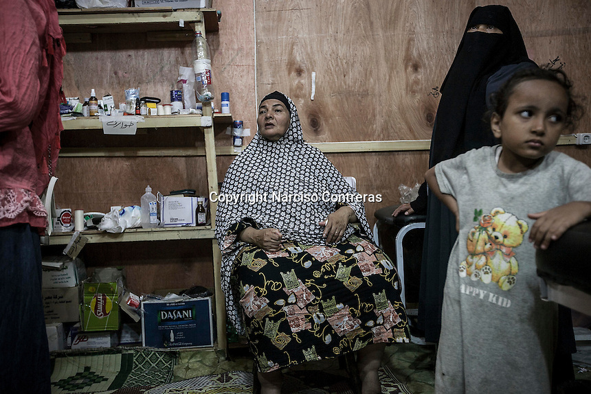 In this Thursday, Aug. 08, 2013 photo, patients await for medical attention at the out patients ward of the field hospital in the sit-in of the Cairo University at Giza district. (Photo/Narciso Contreras).