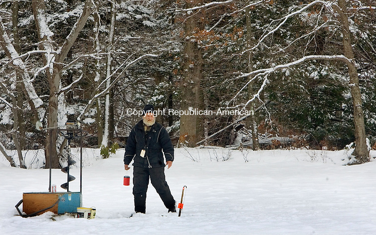 PLYMOUTH, CT. 16 February 2013-021613SV04-Derrel Telke of Terryville found his own little spot to compete in the Terryville Fish & Game's ice fishing derby at Middle Pond on Grove Street in Terryville Saturday..Steven Valenti Republican-American