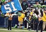 Seattle Seahawks  linebacker Mike Morgan (57) carries the 12th man flag before the game against the Oakland Raiders at CenturyLink Field in Seattle, Washington on November 2, 2014. The Seahawks beat the Raiders 30-24 in Seattle. ©2014. Jim Bryant Photo. All rights Reserved.