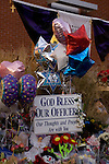 Signs, flowers, balloons, stuff animals, pictures and wreaths form a makeshift memorial to four slain police officers at the Police Headquarters in Lakewood, Washington, USA, on 2 December  2009. Four Lakewood officers were gunned down during a morning meeting at a local coffee shop on 29 November 2009. Jim Bryant Photo. ©2010. ALL RIGHTS RESERVED.
