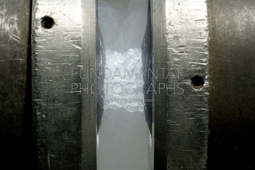 PARAMAGNETISM OF LIQUID OXYGEN<br /> Liquid Oxygen Poured Between the Poles Of A Magnet<br /> Because oxygen is paramagnetic (contains two unpaired electrons) it is attracted into the magnetic field and forms a bridge between the magnetic poles.