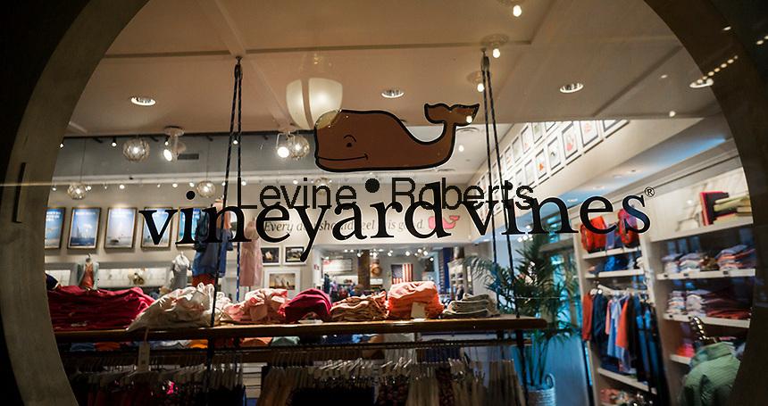 A window display for preppy retailer Vineyard Vines in New York on Sunday, August 14, 2016. (© Richard B. Levine)
