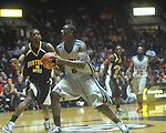 "Ole MIss forward Reginald Buckner (2)  shoots against Southern Mississippi forward Gary Flowers (4) at C.M. ""Tad"" Smith Coliseum in Oxford, Miss. on Saturday, December 4, 2010."