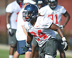 Ole Miss' Keith Lewis (24) goes through a drill at  football practice in Oxford, Miss. on Sunday, August 7, 2011.