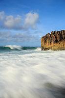 The surf rushes onto the shore along the Maha'ulepu Heritage Trail, southern Kaua'i.