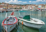 Boats in the harbor of the Mediterranean seaside town of Cassis, France, on a June afternoon.