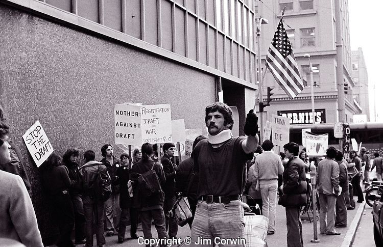 Military veteran  holding the American flag during a war protest