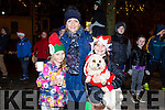 Enjoying the switching on of the christmas lights in Castleisland on Saturday were Niamh O'Connell, Lisa Geaney, Ciara Geaney with Lily the Dog