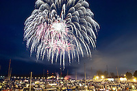 Fourth of July fireworks over Lake Superior at Marquette Michigan.