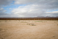The fence marking the border between the United States and Mexico is seen from the Mexican side in the Sonoran Desert on Sunday, Feb. 3, 2008.