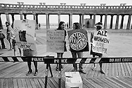 06 Dec 1969, Atlantic City, New Jersey, USA --- Women's Liberation Movement demonstrators carrying picket signs in protest against the Miss America pageant in Atlantic City, New Jersey. --- Image by © JP Laffont/Sygma/CORBIS