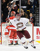 Jimmy Hayes (BC - 10) celebrates Cross's gamewinner. - The Boston College Eagles defeated the Boston University Terriers 3-2 (OT) in their Beanpot opener on Monday, February 7, 2011, at TD Garden in Boston, Massachusetts.