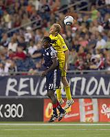 New England Revolution midfielder Shalrie Joseph (21) and Columbus Crew forward Steven Lenhart (32) battle for head ball. The New England Revolution tied Columbus Crew, 2-2, at Gillette Stadium on September 25, 2010.