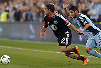Chris Korb (22) defender D.C Utd goes past Paulo Nagamura..Sporting Kansas City defeated D.C Utd 1-0 at Sporting Park, Kansas City, Kansas.