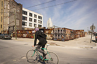 A bicyclist in the Bushwick neighborhood of Brooklyn in New York on Saturday, April 19, 2014. The neighborhood is undergoing gentrification changing from a rough and tumble mix of Hispanic and industrial to a haven for hipsters, forcing many of the long-time residents out because of rising rents.. (© Richard B. Levine)