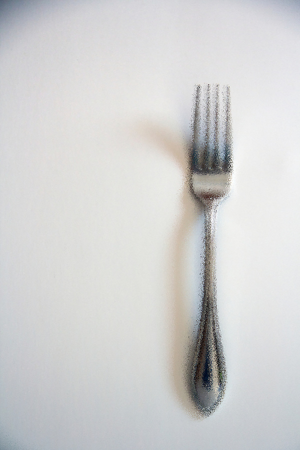 Diner setting silver fork on white background filtered image
