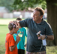 NWA Democrat-Gazette/ANTHONY REYES &bull; @NWATONYR<br /> David Dobbs playfully pats on some silly string to the head of Tate Hinkle, 10, Monday June 22, 2015 during the &ldquo;Vacation Bible School Xtreme&quot; at Robinson Avenue Church of Christ in Springdale. A silly string battle was part of a game where the students answered questions about if a statement was positive or negative. The theme of the school is building each other up and the nights focus was on using words to do that.