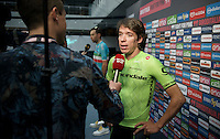 Rigoberto Uran (COL/Cannondale) interviewed ahead of the Grande Partenza in Apeldoorn (NLD) with Vincenzo Nibali (ITA/Astana) behind him<br /> <br /> Team presentation of the 99th Giro d'Italia 2016 on the evening before the 1st stage