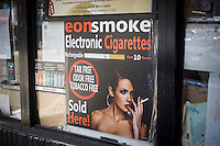 Advertising for electronic cigarettes in the window of a grocery store in  New York on Saturday, February 17, 2013. The alternative to smoking releases water vapor and is advertised as safer being tobacco-free. (© Richard B. Levine)