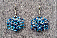 "A pair of chainmail earrings made from blue anodized 18 gauge aluminum rings  and 19 gauge 5/32"" bright aluminum rings woven in a dragonscale pattern.  Made by Michelle."
