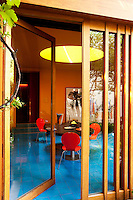 Large glass doors lead from the open-plan dining area into the garden