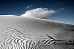 Bluse sky above white desert with ripples in sand in America