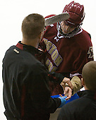 Bert Lenz (BC - Dir-Sports Medicine) works on Chris Kreider's (BC - 19) finger which was cut at the end of the game. - The Northeastern University Huskies defeated the visiting Boston College Eagles 2-1 on Saturday, February 19, 2011, at Matthews Arena in Boston, Massachusetts.