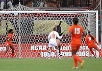 COLLEGE PARK, MD - OCTOBER 28, 2012:  Danielle Hubka (34) (out of the photo) of the University of Maryland beats Emily Lillard (2) of Miamifor the game winning goal during an ACC  women's tournament 1st. round match at Ludwig Field in College Park, MD. on October 28. Maryland won 2-1 on a golden goal in extra time.