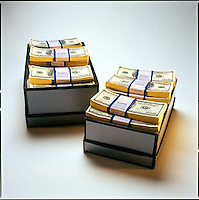 Shoe boxes filled with stacks of $100 bills<br />