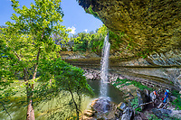 We capture a series of  waterfall images at Hamilton Pool located outside of Austin. This natural pool was created by an underground river dome that collasped and after thousand of years of  erosion this swimming hole for formed. The erosion created this cave with stalactite growing from the celling, a waterfall flowing over the limestone bolders along the waters edge with moss and the highlight the natural emerald green swimming hole along with a sandy beach. The preserve includes about 232 acres of natural habitat and is home to the golden cheek warble. This place draws a lot of people want to enjoy this place on a hot summer days but if you want to come be sure and call ahead and make reservation. Over the years the place has been loved to death and you now need a reservation just to get in also it is also good to make sure it is open for swimming because it is a natural swimming hole no chemicals are added to the water so at times it get shut down due to high bateria counts. This nature preserve is part of the Balcones Canyonlands Preserve and is a protected environment.