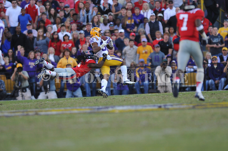 LSU wide receiver James Wright (82) makes a catch as Ole Miss defensive back Charles Sawyer (3) defends at Tiger Stadium in Baton Rouge, La. on Saturday, November 17, 2012. The play was called back due to a holding penalty.....