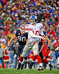 23 December 2007: New York Giants quarterback Eli Manning drops the ball prior to making the pass, but recovered his own fumble against the Buffalo Bills at Ralph Wilson Stadium in Orchard Park, NY. The Giants defeated the Bills 38-21. ..Mandatory Photo Credit: Ed Wolfstein Photo