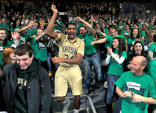 Jan. 22, 2011; Carleton Scott celebrates with the student section after Notre Dame defeated Marquette 80-75 at the Purcell Pavilion. ..Photo by Matt Cashore
