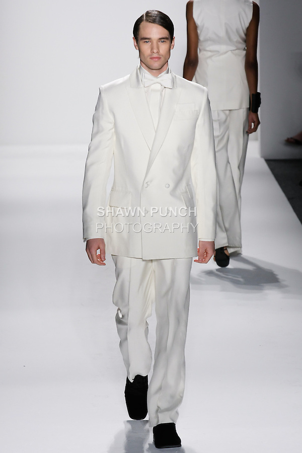 Model walks runway an MEN&rsquo;S IVORY ITALIAN SILK DUPIONI D/B SUIT W/ HAND TOP STITCHING AND  MEN&rsquo;S IVORY ITALIAN SILK DUPIONI DRESS SHIRT W/BOW TIE by Zang Toi, for the Zang Toi Spring 2012 My Dream Of North Africa Collection, during Mercedes-Benz Fashion Week Spring 2012.