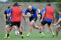 Matt Garvey of Bath Rugby takes on the defence. Bath Rugby training session on August 4, 2015 at Farleigh House in Bath, England. Photo by: Patrick Khachfe / Onside Images