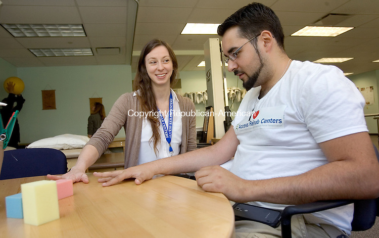 MIDDLEBURY CT. 08 May 2015-050815SV03-From left, Mellissa Noonan, OTR, helps Kino Benedict of Waterbury with some hand movements at Access Rehab at Middlebury Edge in Middlebury Friday.<br /> Steven Valenti Republican-American