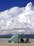 A storm approaches a vacationer on Tiger Tail Beach on Marco Island Flrodia. Erik Kellar