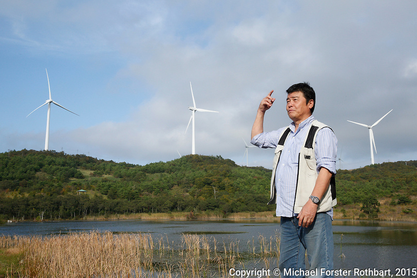 Takaaki Ide, a farmer, factory worker and former evacuee, has returned to his home in Kawauchi, Fukushima. I wrote about the Ide family in my TED book, Would You Stay? When I met them in 2012, they were living in temporary evacuation housing in Koriyama city, 20 miles west [as the crow flies, 27 miles or one hour by road] of their family farm in the Abukuma mountains. One of the first things Takaaki told me then was how he missed the trees that surround the home. <br /> <br /> Today, Takaaki and his wife Yumiko are delighted to be back home but they&rsquo;ve kept their new factory jobs in the city. &ldquo;I still collect mushrooms but the radiation is too high, we can not eat them,&rdquo; he says. He worries about their future: &ldquo;I worry a little about the nuclear power plant but more I worry, will my son come home? He&rsquo;s 28 years old. I worry &mdash; will I have good health to keep working?&rdquo;<br /> <br /> Takaaki takes me to see a windmill farm on the mountaintop above their farm. This is the energy future for Fukushima, he tells me &mdash; the soil is contaminated but the wind blows clean.<br /> <br /> In March 2011, an earthquake and tsunami hit northern Japan and destroyed the Fukushima Daiichi nuclear power plant. Some 488 thousand people evacuated from the three-part disaster; in 2015, nearly 25% remain displaced.<br /> <br /> A massive effort is now underway to decontaminate towns in the Fukushima Exclusion Zone. In Tomioka, 5 to 8 miles from the nuclear plant, thousands of laborers are cleaning or demolishing every building, and removing and incinerating all topsoil in inhabited areas. In the adjacent forests and mountains, radiation levels remain higher and will not be cleaned.<br /> <br /> Naraha, 12 miles south of the nuclear plant, is the first town to reopen after the disaster. Residents were allowed to return home full-time on Sept. 5, 2015. To date, an estimated 440 residents have returned, out of a pre-disaster population of 7,400. <br /> <br /> I returned to Fukushima one week after Naraha reopened and spent a month there, interviewing