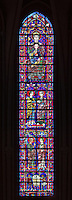 The Haute Verriere de Nostre Dame, with (top to bottom), the Virgin and child, the Visitation, the Annunciation and the donor window of the bakers, stained glass window, 13th century, in the centre of the apse of Chartres cathedral, Eure-et-Loir, France. Chartres cathedral was built 1194-1250 and is a fine example of Gothic architecture. Most of its windows date from 1205-40 although a few earlier 12th century examples are also intact. It was declared a UNESCO World Heritage Site in 1979. Picture by Manuel Cohen
