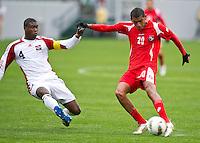 CARSON, CA - March 25, 2012: Sheldon Bateau (4) of Trinidad & Tobago and Anibal Godoy (20) of Panama during the Panama vs Trinidad & Tobago match at the Home Depot Center in Carson, California. Final score Panama 1, Trinidad & Tobago 1.