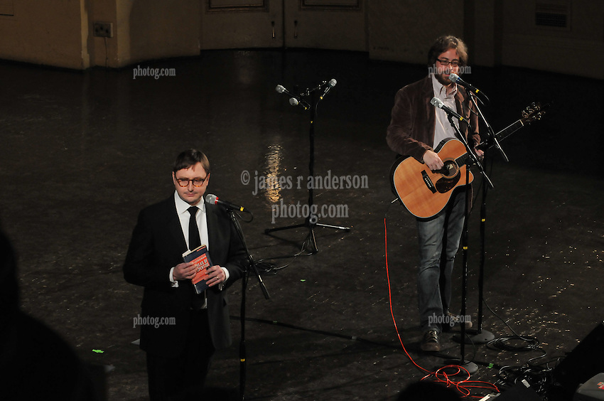 """Someone off stage distracting the comedy team, Jon Hodgman and Jonathan Coulton, as they try to set the mood for the """"Concert of the Century"""" on a Spree: The Whiffenpoof Centennial (1909-20090"""