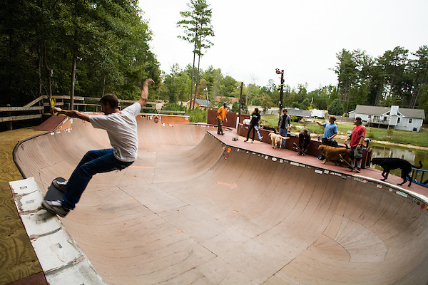 September 19, 2007, Pittsboro, NC.. Frank Gullo does a frontside 5-0 grind on the 6 ft. wall of the bowl.. The skateboard bowl owned by Tony Sabbagh, located about 10 miles from Pittsboro, NC. Tony and his friend Frank Gullo, constructed the bowl over the course of the last 4 years and have people over weekly to skate and hang out.